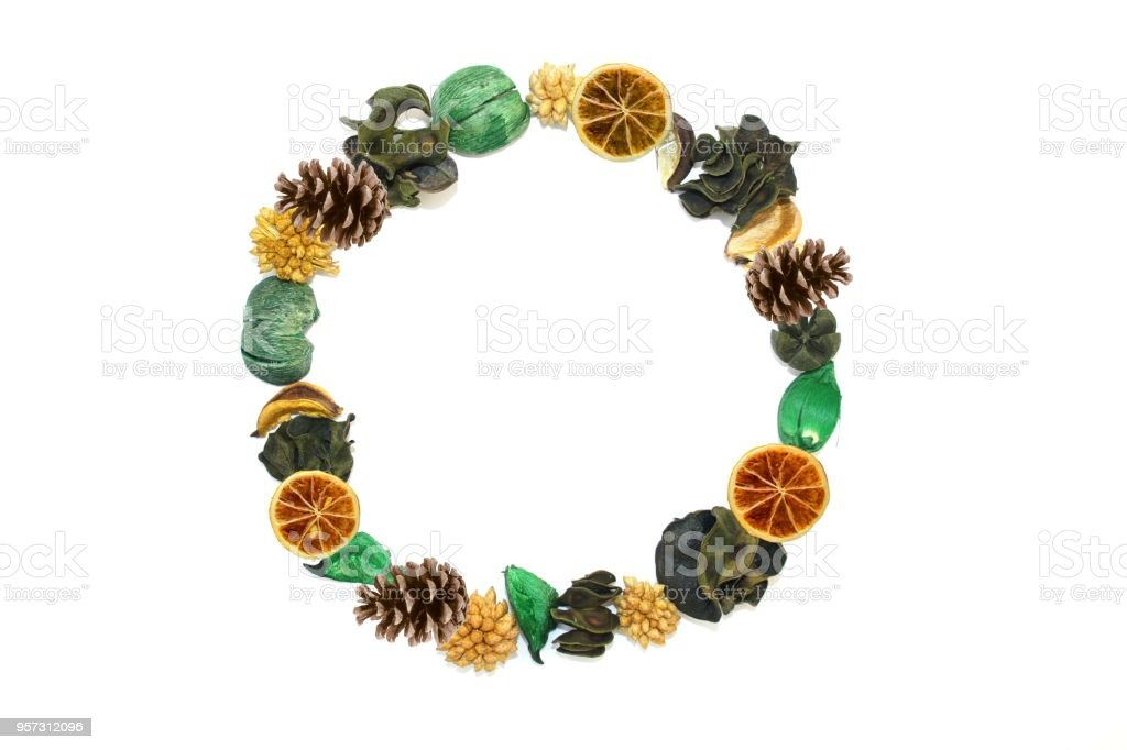 Christmas frame wreath with exotic dried flowers, cones and citrus. Handmade. Christmas composition. flat lay. stock photo