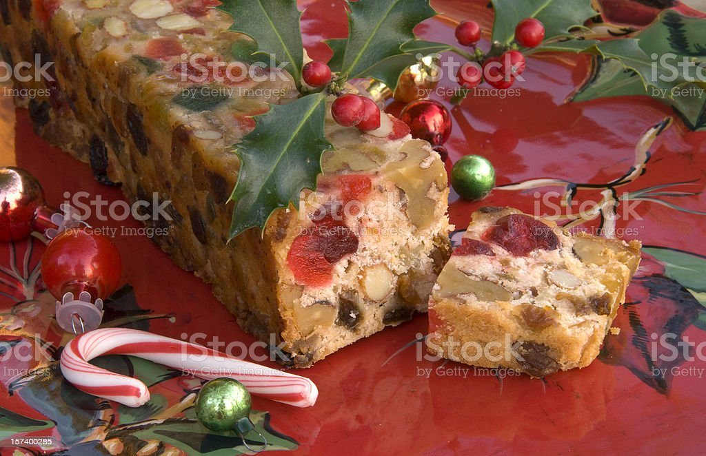 Christmas Fruit Cake & Peppermint Candy Cane, Holiday Dessert Food Background stock photo