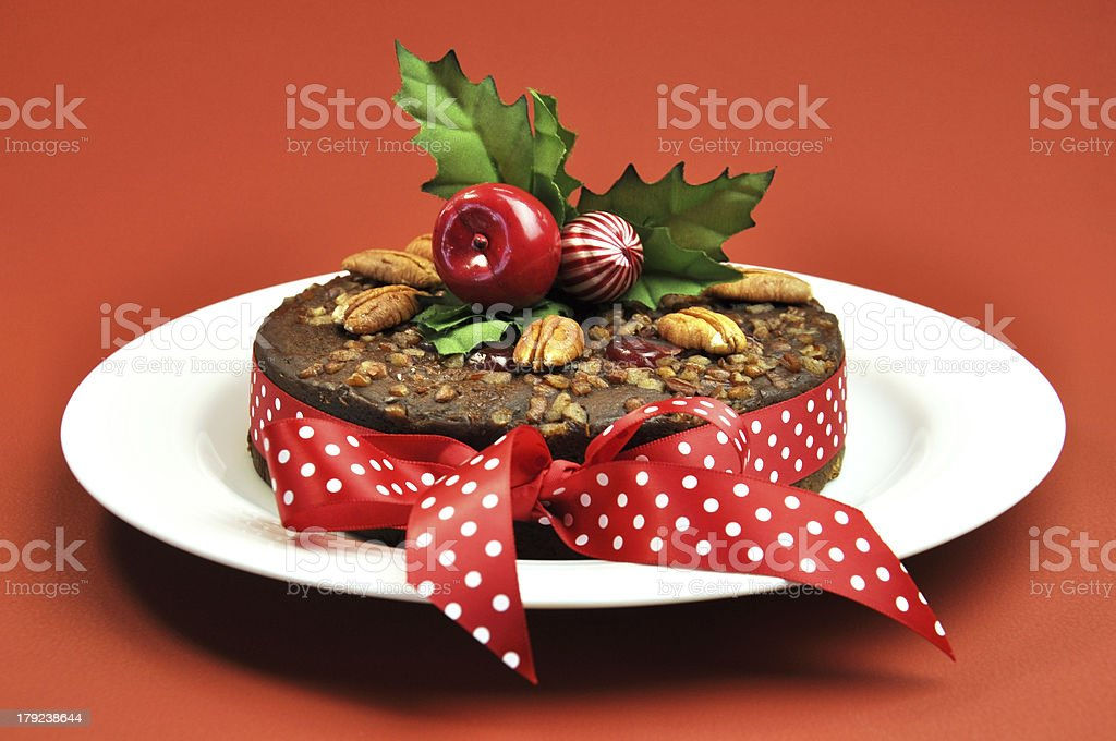 christmas fruit cake with festive decorations on a red bckground royalty free stock photo - Christmas Fruit Cake Decoration