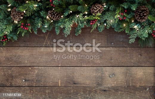 Christmas holiday garland on an old rustic wood background