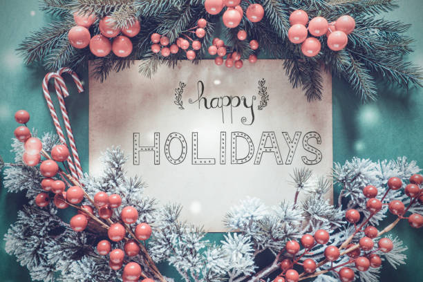 christmas garland, calligraphy english text happy holidays - happy holidays stock pictures, royalty-free photos & images
