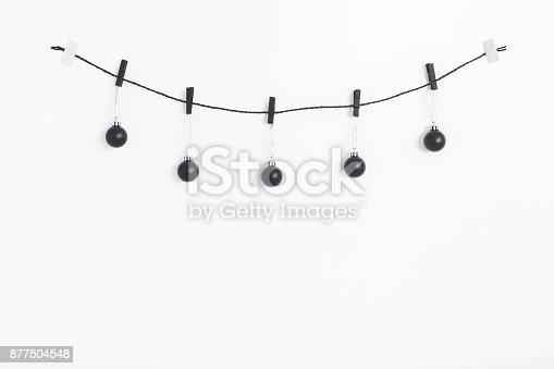 1064023690 istock photo Christmas garland made of black balls. Flat lay, top view 877504548