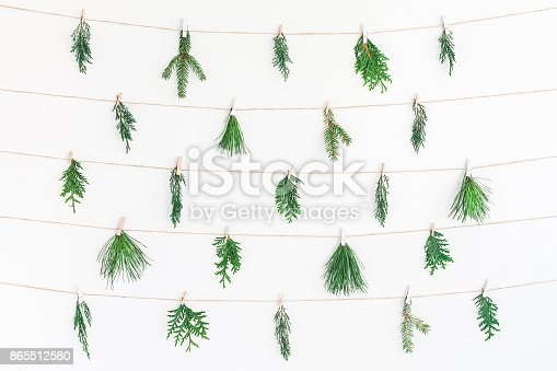 1064023690 istock photo Christmas garland made of winter plants. Flat lay, top view 865512580