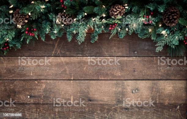 Christmas garland on an old wood background picture id1067584666?b=1&k=6&m=1067584666&s=612x612&h=jfe5z78qcbnnuelfas95opx jkk74nmmzpbqpiyj2ae=