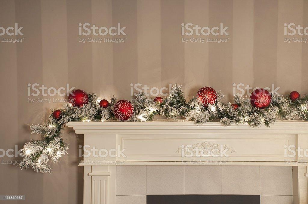 Christmas Garland on Fireplace stock photo