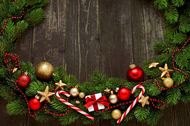 Christmas Garland On Rustic Wood With Copy Space Stock Photo