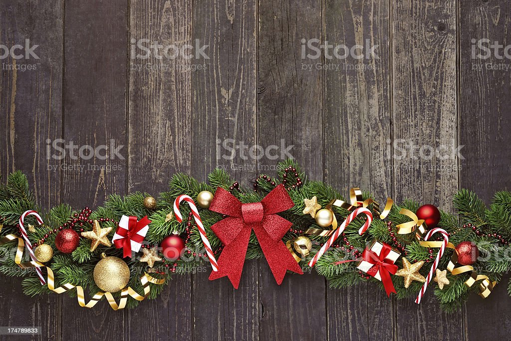 Christmas garland on rustic wood with copy space royalty-free stock photo