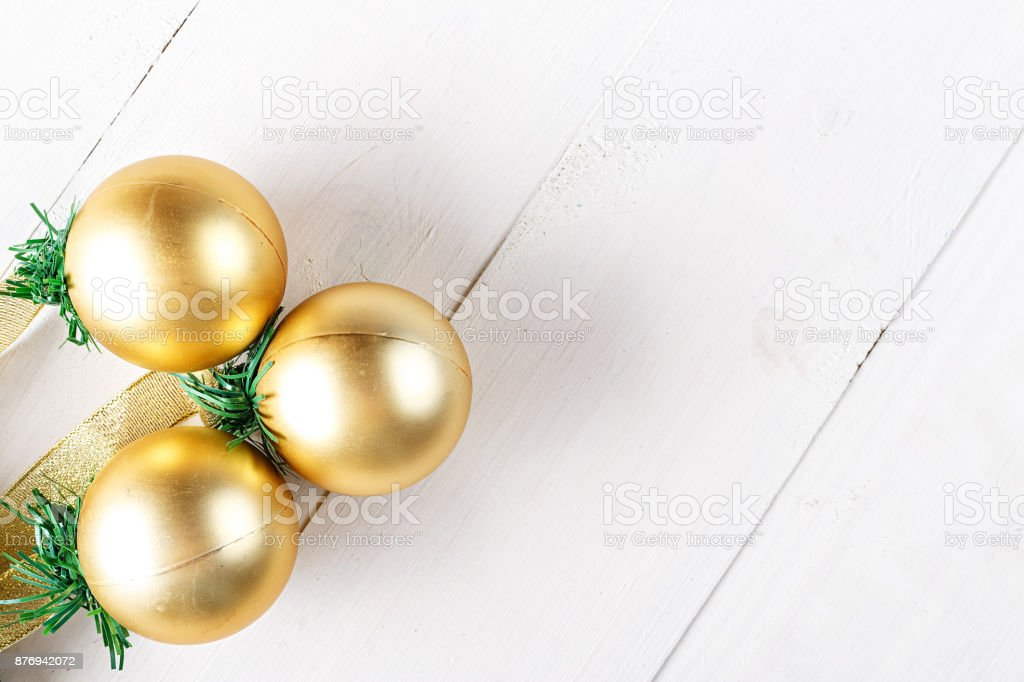 Christmas garland with toys gold balls on white background stock photo