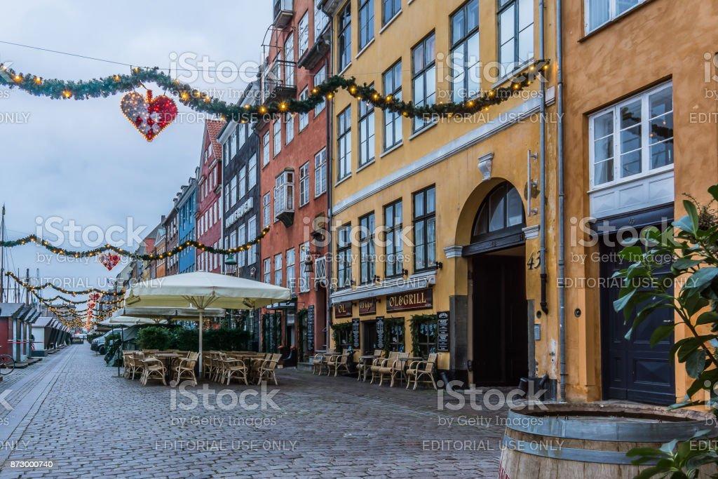 Christmas garlands over the street at Nyhavn , Copenhagen stock photo