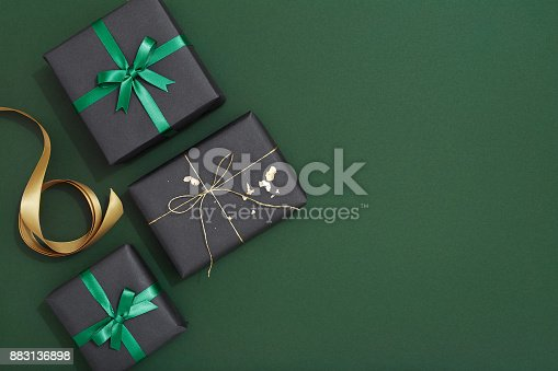 istock Christmas gif flat lay on green background 883136898