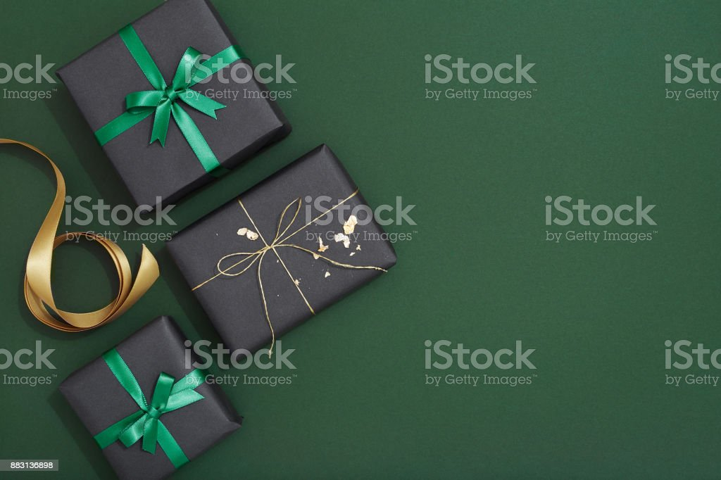 Christmas gif flat lay on green background stock photo