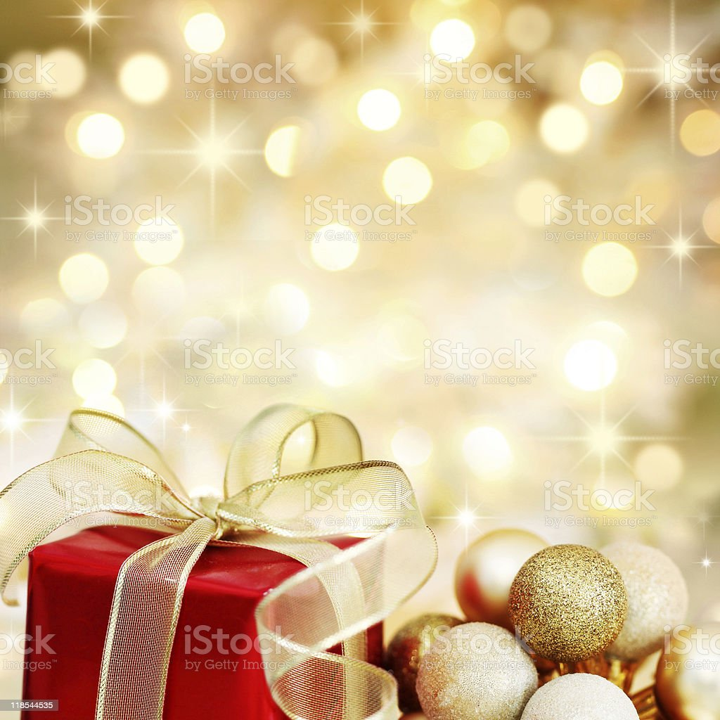 Christmas gift and baubles with golden lights stock photo