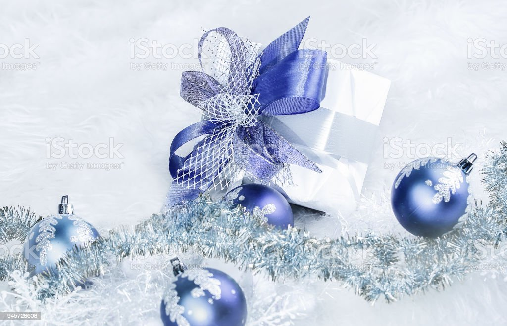 christmas gift and blue christmas balls on a festive white back royalty free stock photo - Blue Christmas Balls