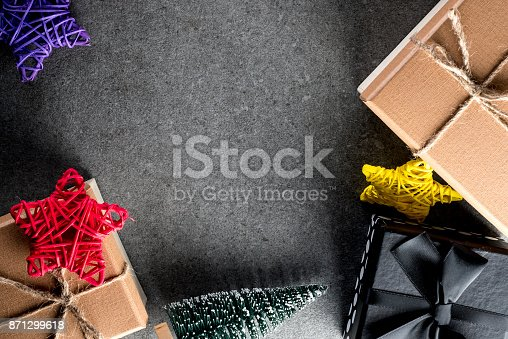istock Christmas gift and toys on old retro vintage style texture background. Empty copy space for inscription Idea of merry new year 2018 holiday 871299618