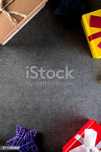 istock Christmas gift and toys on old retro vintage style texture background. Empty copy space for inscription Idea of merry new year 2018 holiday 871299868