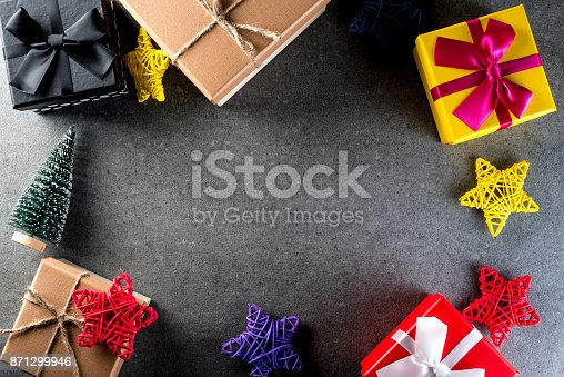 istock Christmas gift and toys on old retro vintage style texture background. Empty copy space for inscription Idea of merry new year 2018 holiday 871299946