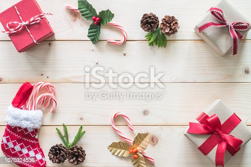 istock Christmas gift background with red box of present on white pine wood background for X'mas winter holiday backdrop and design decoration 1070324536