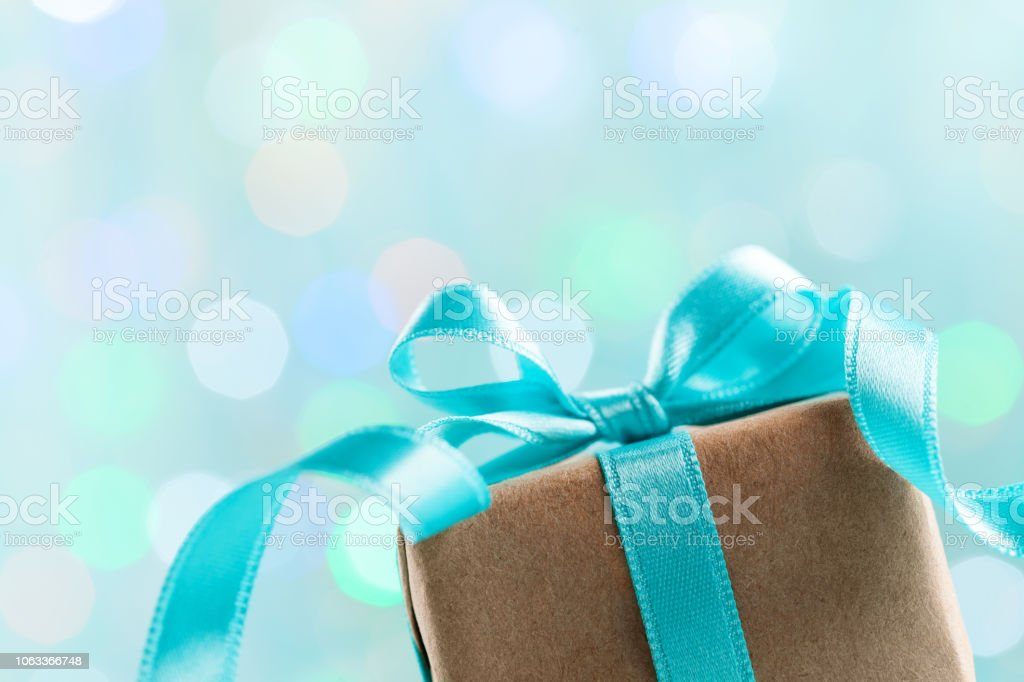 Christmas gift box against turquoise bokeh background. Vintage...