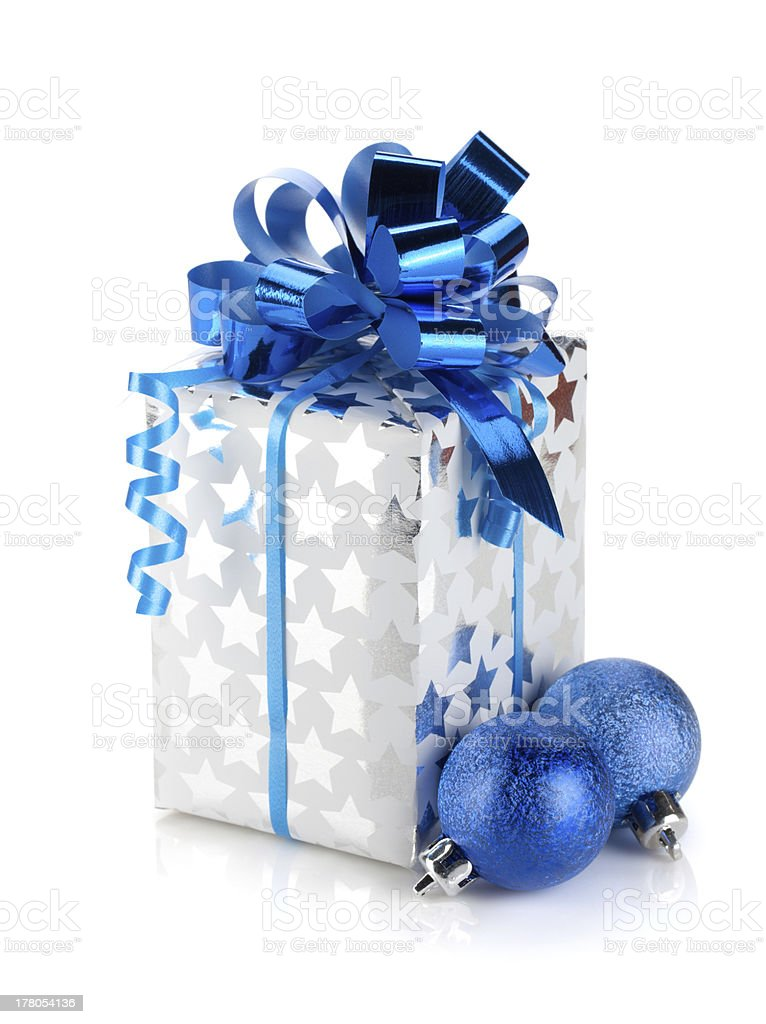 Christmas gift box and blue baubles royalty-free stock photo