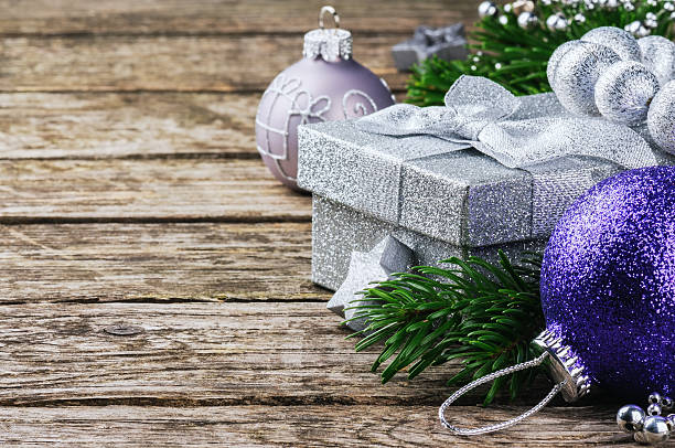 Christmas gift box and festive ornaments stock photo
