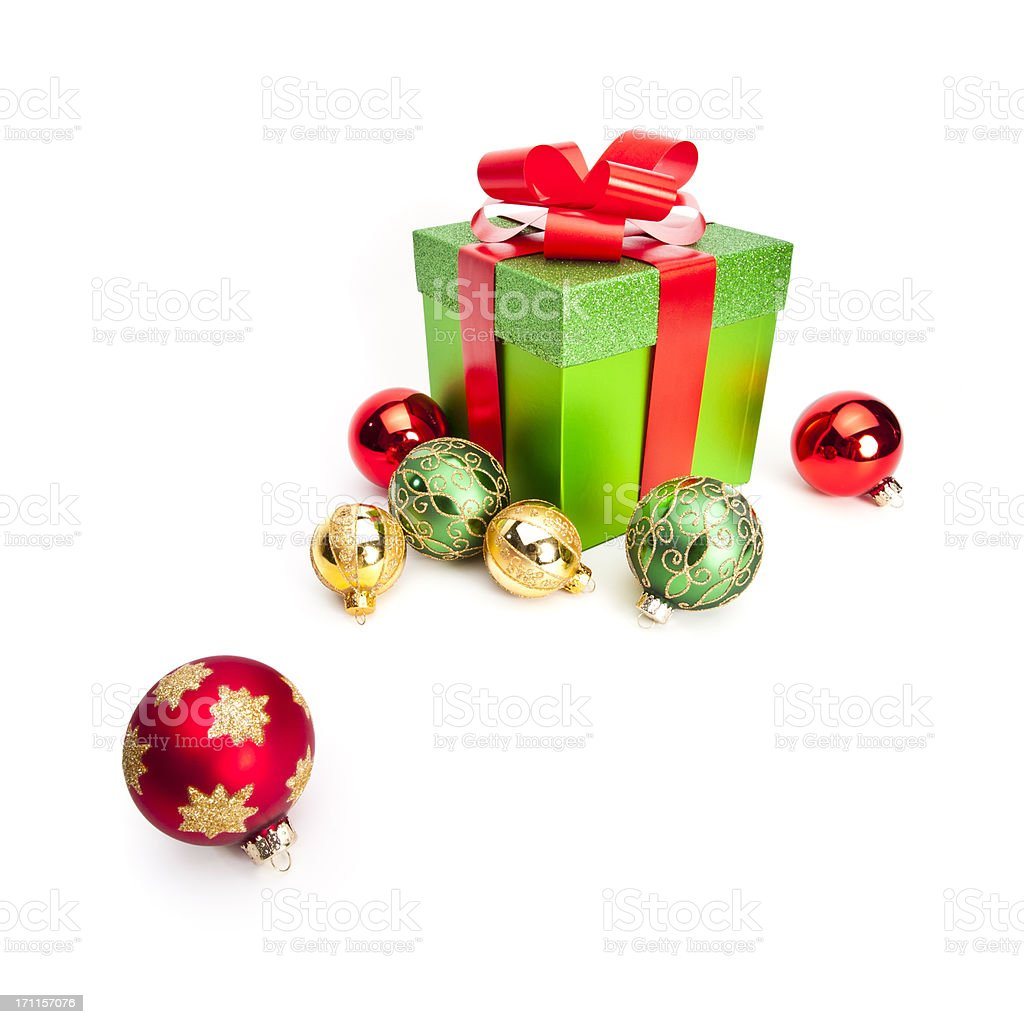 Christmas gift box and ornaments on white royalty-free stock photo