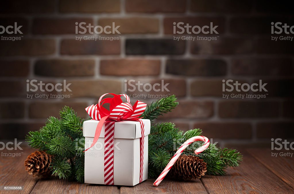 Christmas gift box and tree branch stock photo