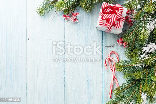 istock Christmas gift box, candy cane and fir tree 494664336