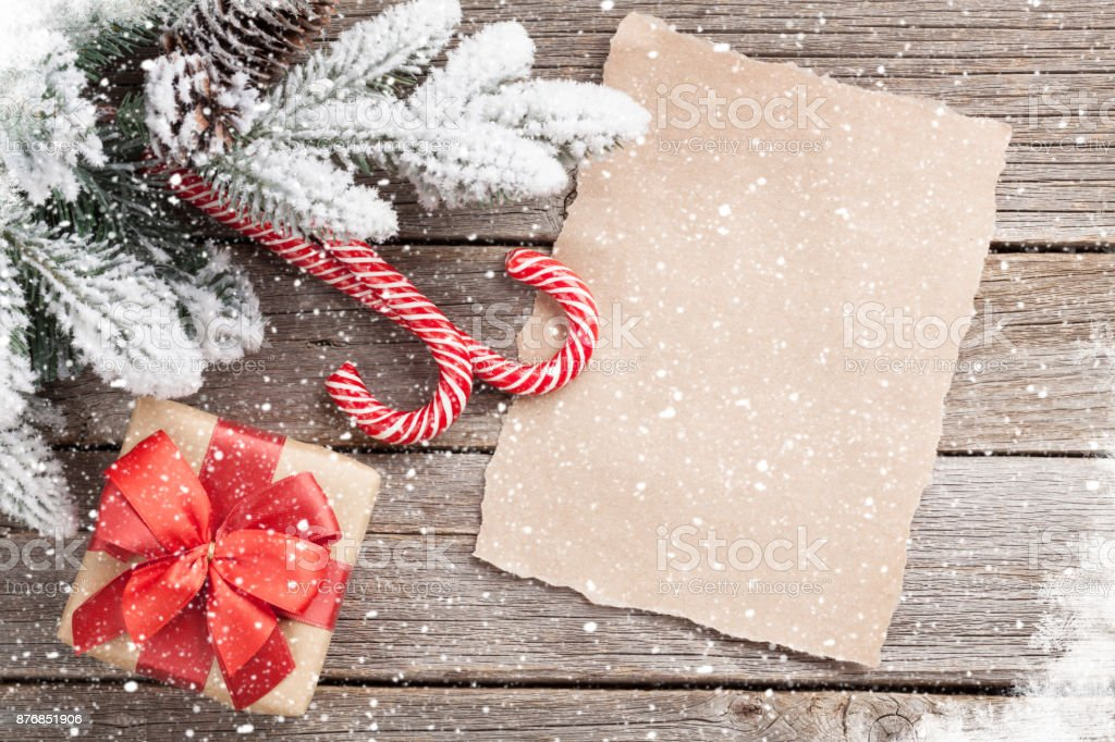 Christmas gift box, candy canes and fir tree stock photo
