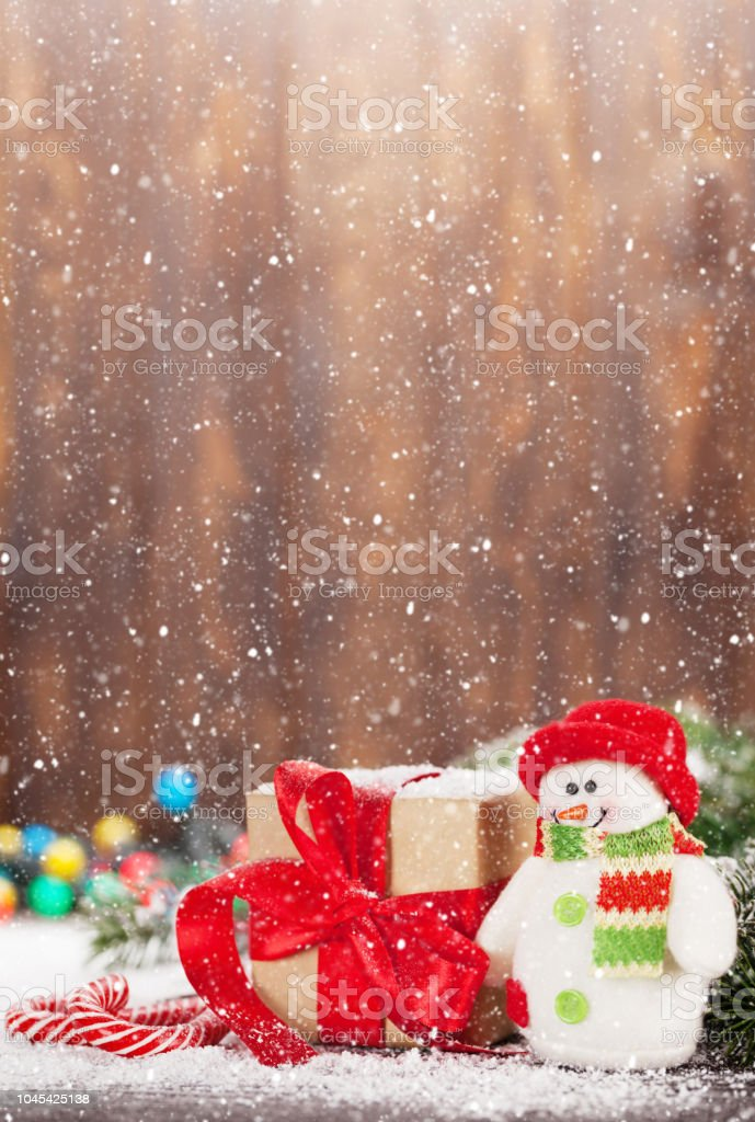Christmas gift box, candy canes and snowman stock photo