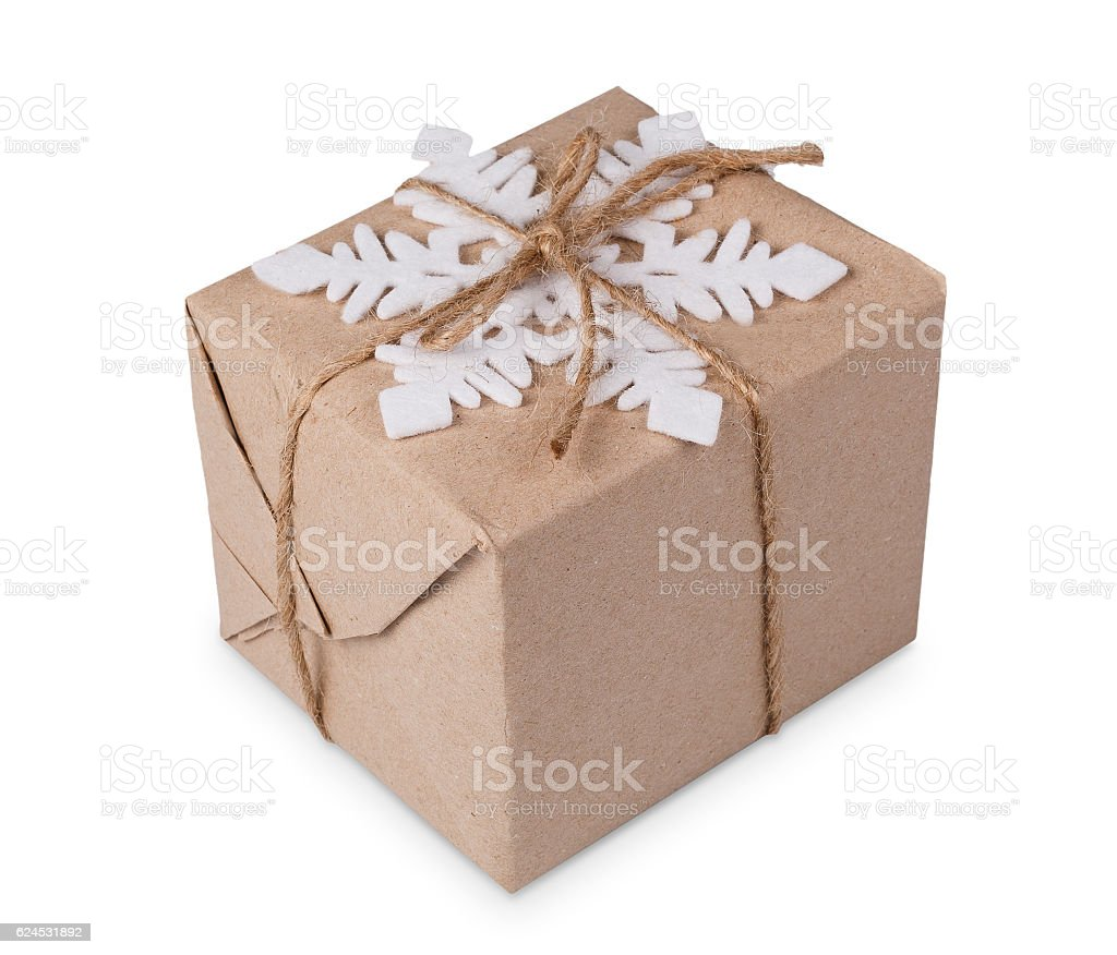 Christmas gift box in craft paper isolated on white stock photo