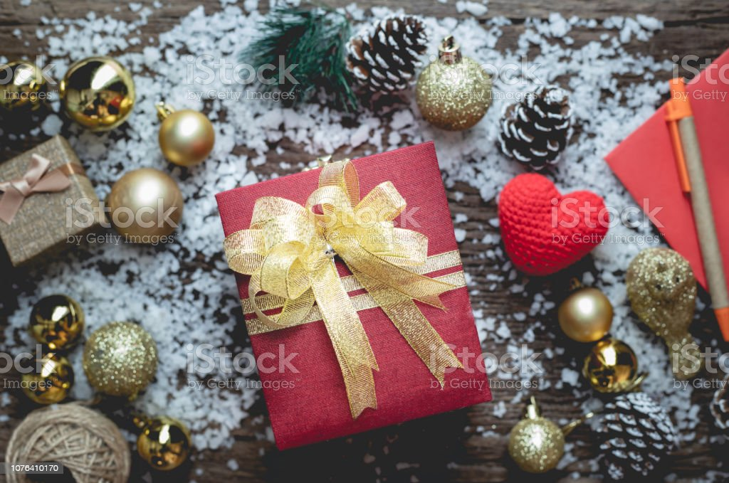 Christmas gift box on Christmas composition on wooden table texture...