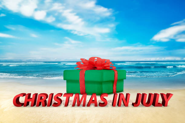 christmas gift box on the beach - july stock photos and pictures