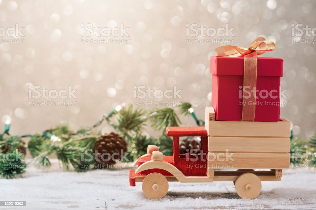 Christmas gift box on toy truck stock photo