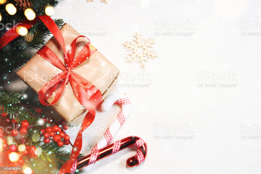 Christmas Gift Box On Wooden Background With Snowflakes Greeting ...