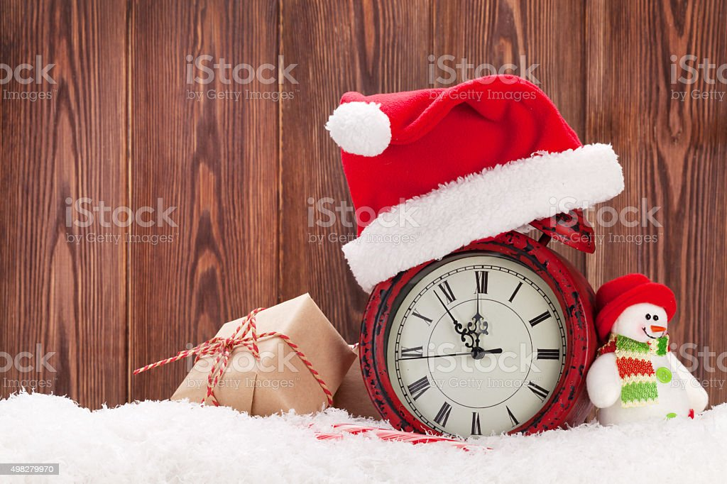 Christmas gift box, snowman and alarm clock stock photo