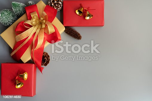 865140324 istock photo Christmas gift box to celebrate Christmas and Happy new year on gray background 1062814630