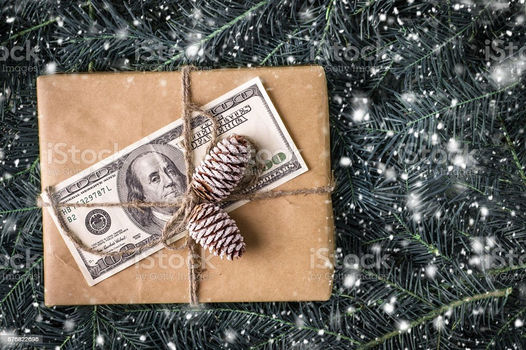 christmas gift box with banknote of dollar.  Christmas Card stock photo