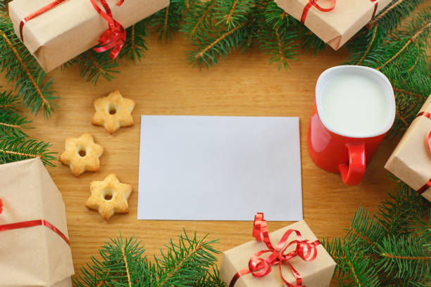 Christmas gift box with cup of milk and Christmas tree stock photo