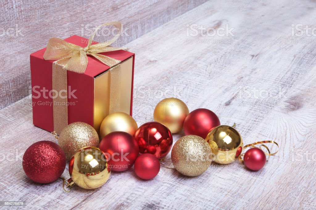Christmas gift box with red and gold balls royalty-free stock photo