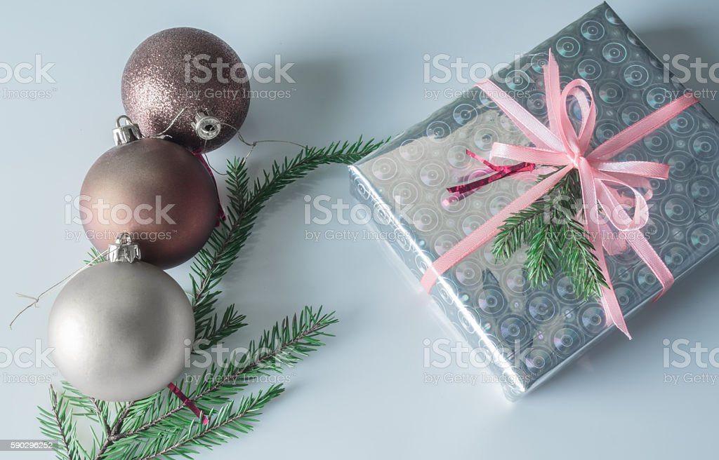 Christmas gift box wrapped in sparkling paper royaltyfri bildbanksbilder