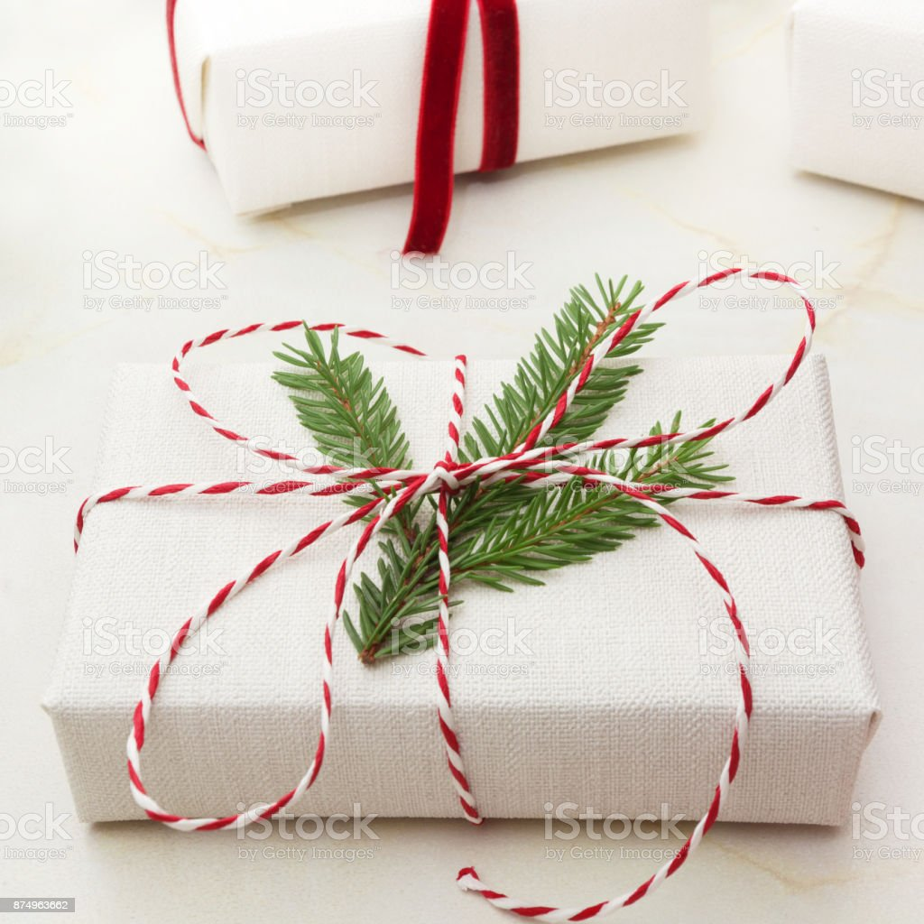 Christmas Gift Box Wrapped In White Craft Paper And Decorative Red Rope Ribbon On Marmoreal Surface Creative Hobby Square Image Close Up Stock Photo Download Image Now Istock