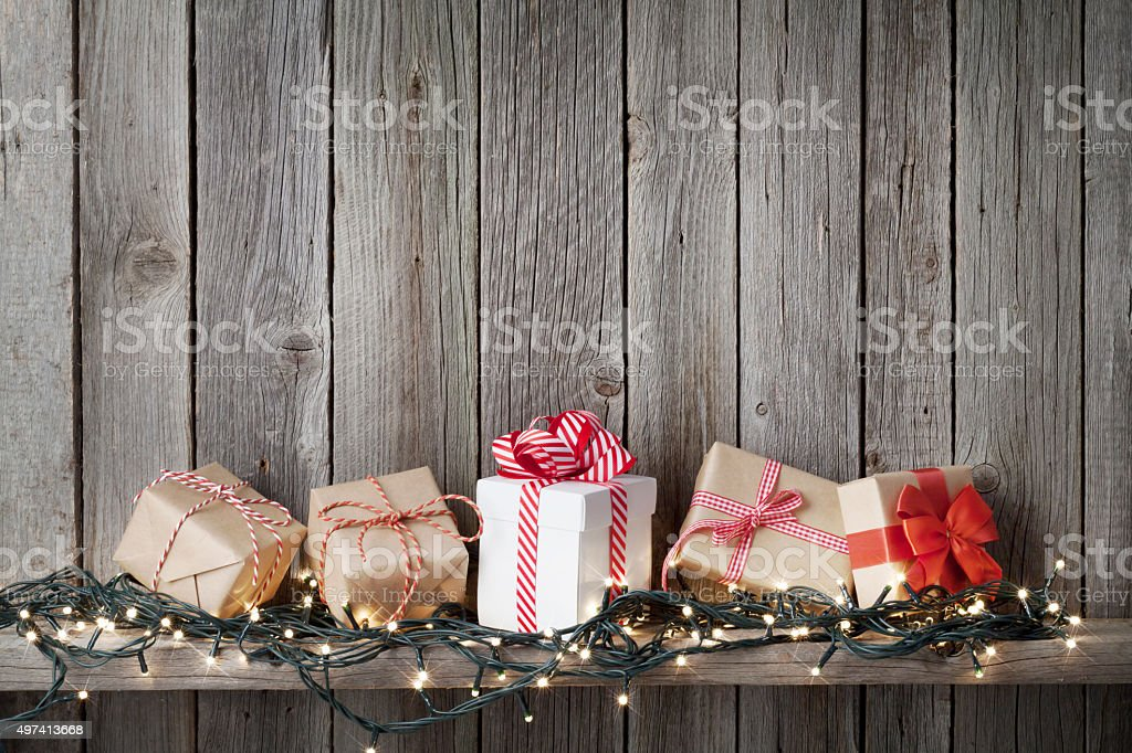 Christmas gift boxes and lights stock photo