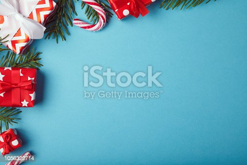 istock Christmas gift boxes background with christmas decoration 1056322714