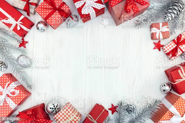 Christmas gift boxes decorations and silver fir tree branches on picture id873103690?b=1&k=6&m=873103690&s=612x612&h=sv3aabgrle7yo7rml0gbcohygifffvupxcfijcqth4i=