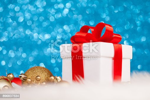 istock Christmas gift boxes in shiny blue night 896837534