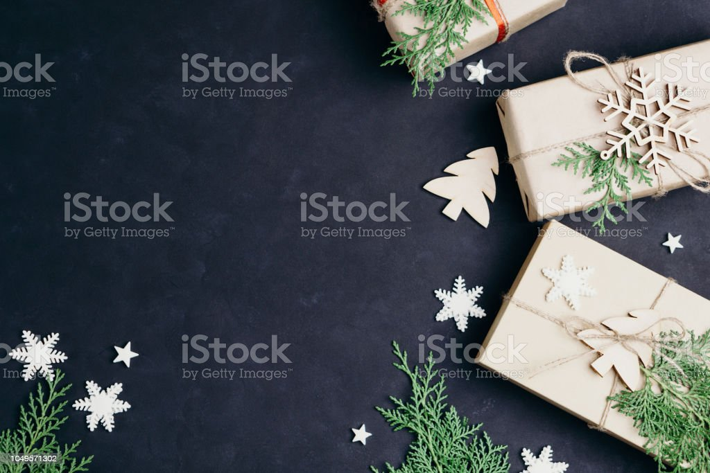 Christmas gift boxes on dark background, flat lay stock photo