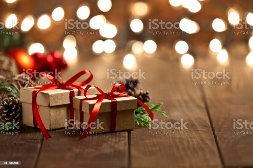 Christmas gift boxes on rustic wooden table stock photo
