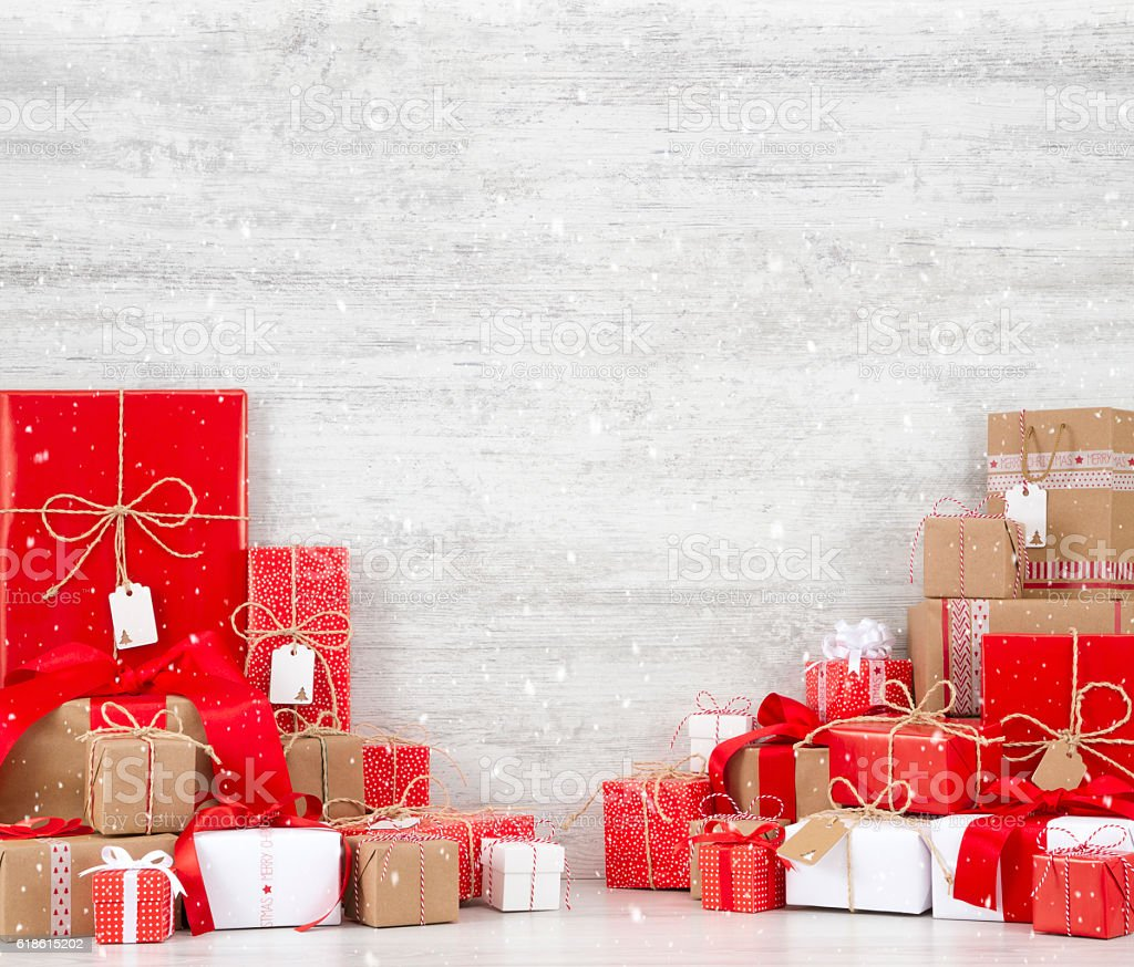 Christmas Gift Background: Christmas Gift Boxes On Snowy Wooden Background Stock