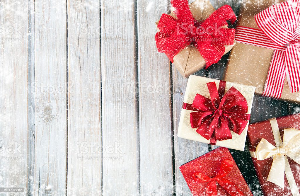 Christmas gift boxes on wooden snowy table stock photo