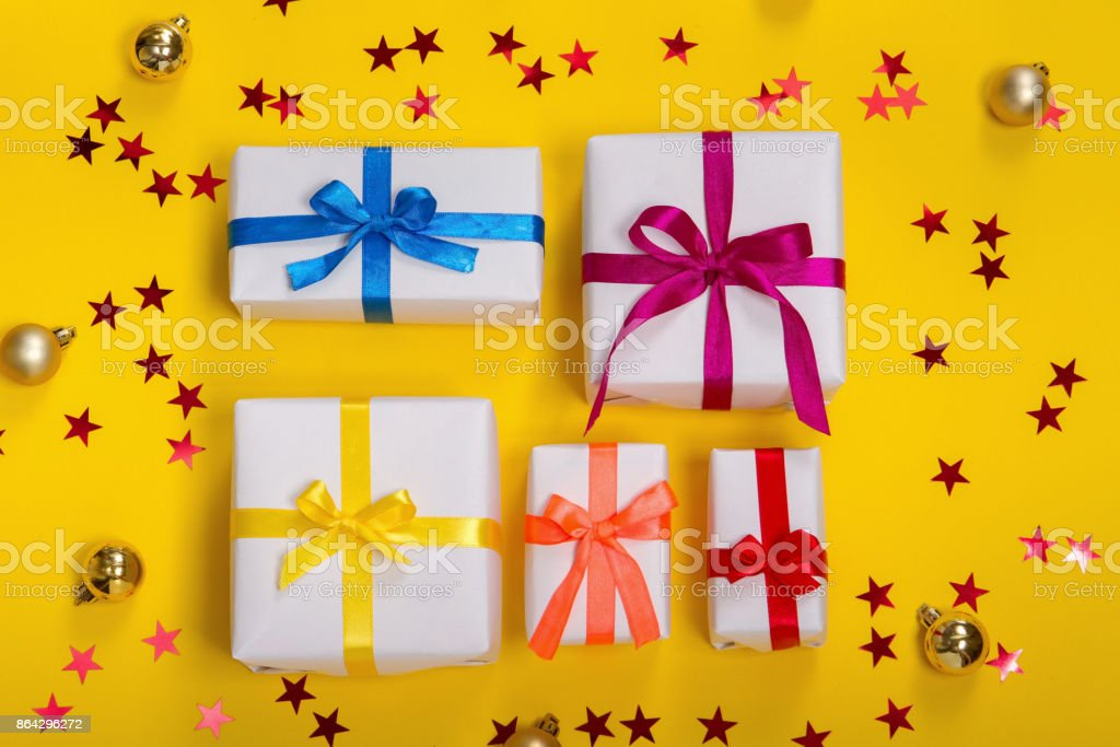 Christmas gift boxes on wooden table with snow. Top view with copy space royalty-free stock photo